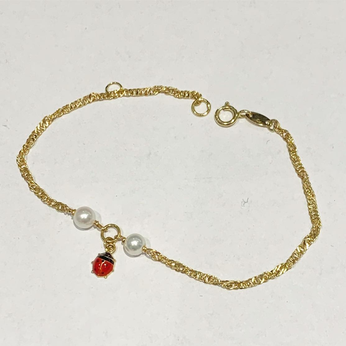 Armlenke gull 14+2cm singapore m/2 perler/marihøne