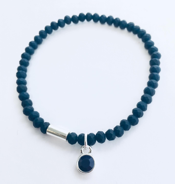 Armlenke rhod. rund blå sten på slipte mørkblå stener(strikk)