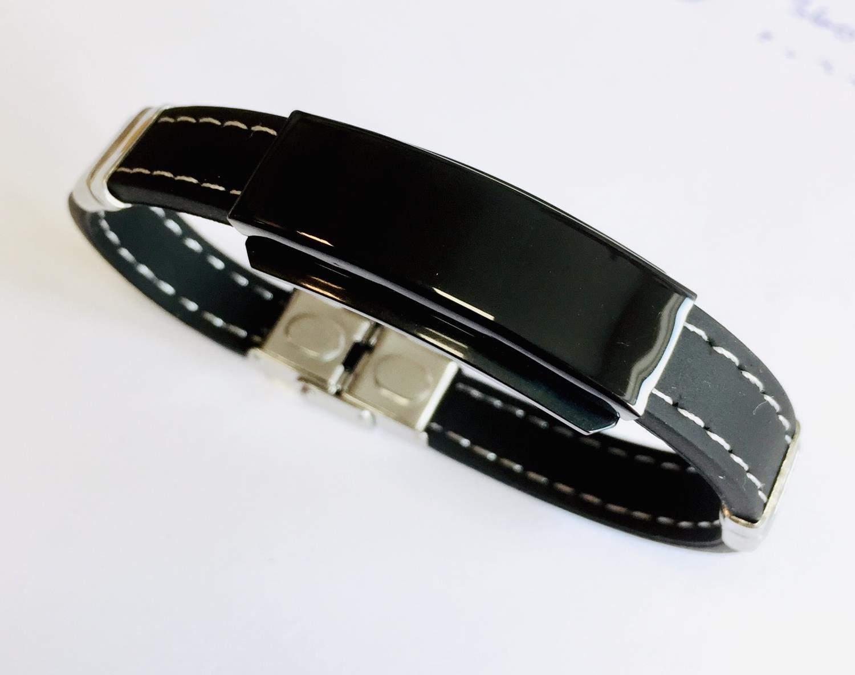 Armlenke sort stål plate på sort skinnreim