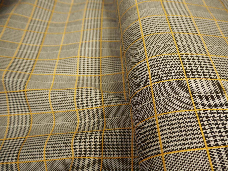 Rutet i grå og gule farger, jersey pris pr 10cm