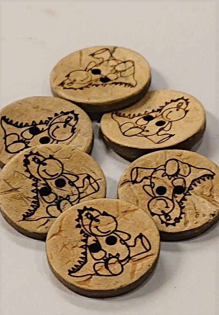 Knapp: Dinoknapp i kokosmateriale
